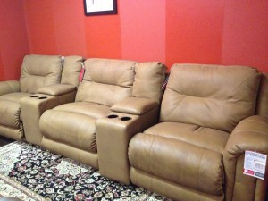 Big and comfy! LANE Home Furnishings three seater with two consoles and 4 cupholders with storage. POWER recline on the outside two seats and manual on the inside recliner. Normally retails for $2795. THIS ONE ONLY floor model closeout for 60% off! $1120